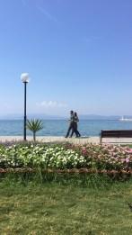 Couple walking along seafront, Turkey