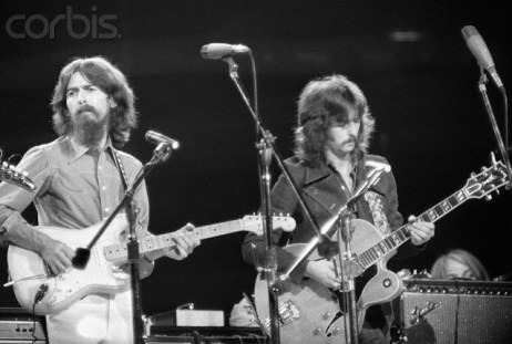 01 Aug 1971, George Harrison and Eric Clapton at the Concert for Bangladesh at Madison Square Garden. --- Image by © Bettmann/CORBIS