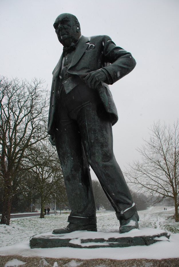 Snow on the statue of Winston Churchill, who was Conservative MP for Woodford from 1945 to his retirement in 1964.