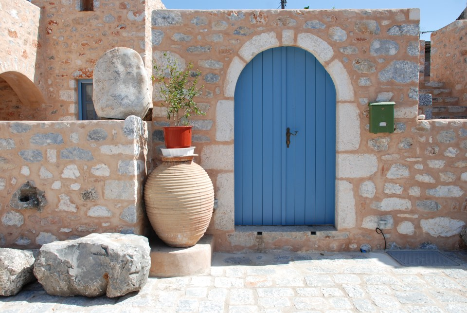 Behind the blue door in Areopoli, capital of the Mani, is a hotel in a restored tower house