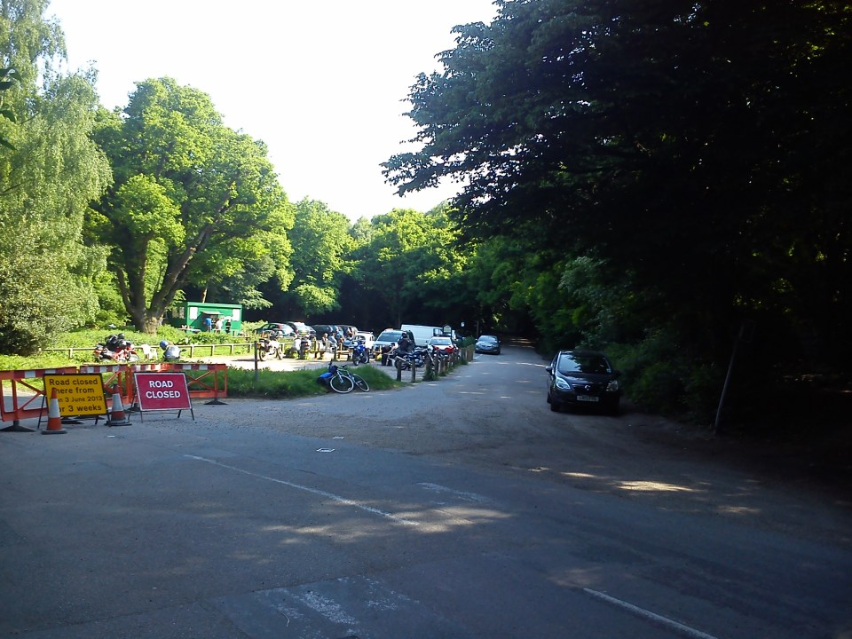 Road closure at High Beach but there's no through road to the right. The single signpost is hidden in the shade of the trees