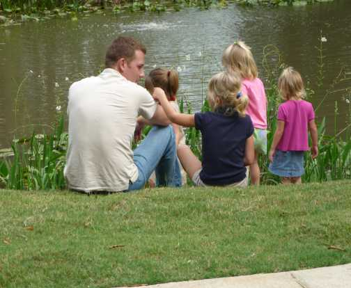 daddy and the ladies at the flower garden