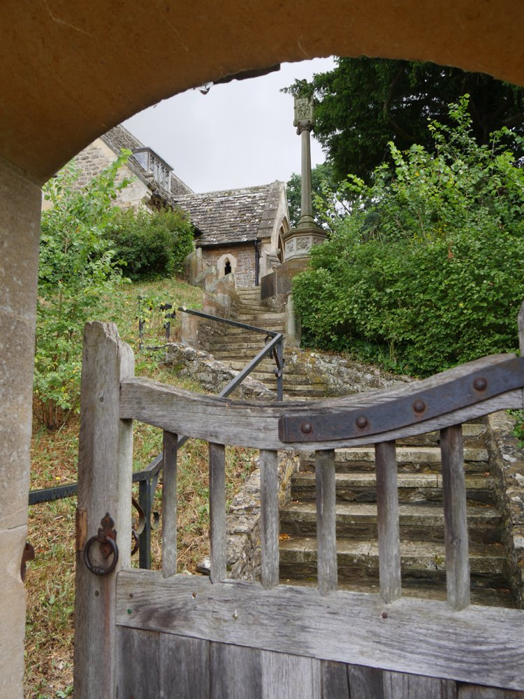 The church gate opens to stone steps winding up to the entrance.