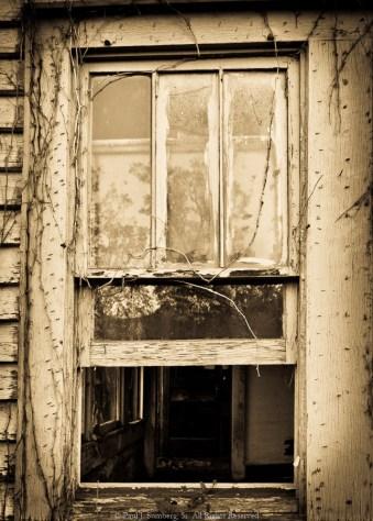 Window on an abandoned farm house