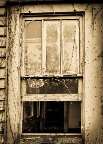 Window on an abandoned farm house
