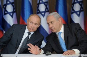 Visiting Russia's President Vladimir Putin (L) and Israeli Prime Minister Benjamin Netanyahu R) speak after making their joint statements following their meeting and a lunch in the Israeli leader's Jerusalem residence, on June 25, 2012. Putin is on  a rare trip to Israel where he is expected to hold talks on the situation in Syria and Iran's nuclear programme. AFP PHOTO/ RIA-NOVOSTI/ POOL/ ALEXEY DRUZHININ        (Photo credit should read ALEXEY DRUZHININ/AFP/GettyImages)
