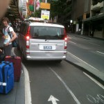a sydney taxi parks in a city bike lane
