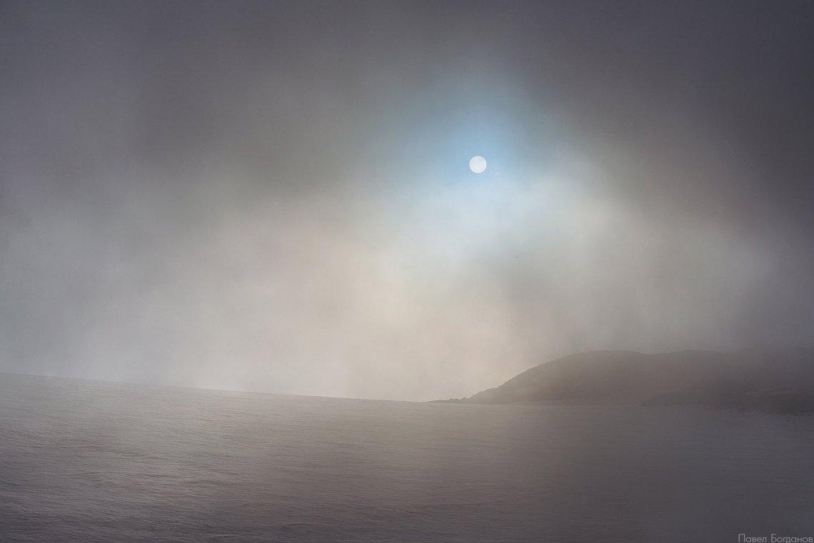 Солнце через облака