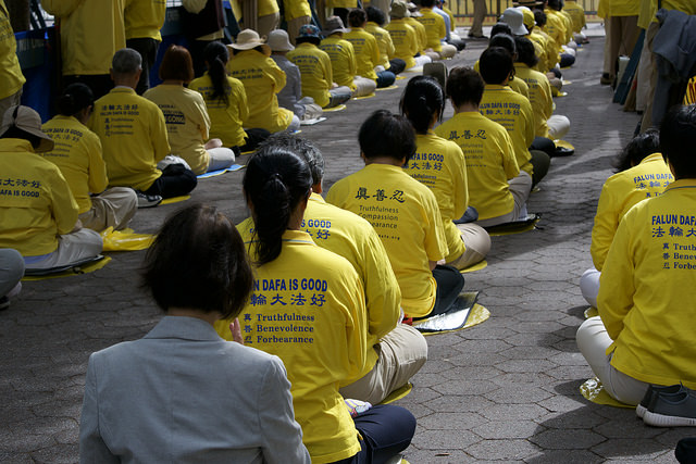 falun gong and falun dafa protestors meditate in new york city