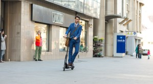 Using Electric Scooter on the street on a sunny day with sarf effect and blurry. Editorial content.