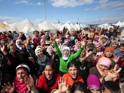 Syrian refugees protest against President Bashar al-Assad.