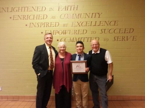 Donald Levan, Sharon Halsey-Hoover, award recipient Eddie Motta, and David Hoover of Pax Christi Southern California.