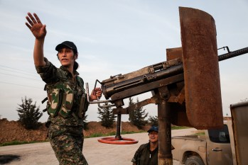 Female Kurdish fighter with heavy machinegun