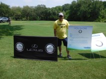 Robby Moore in front of Hole 7, where players tried their luck at a hole-in-one for a shot at winning a 3 year lease on a Lexus RX350
