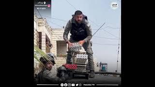 عدسة المصور الصحفي هشام أبو شقرة ترصد سيارة عسكرية للاحتلال أثناء تزويدها  بقنابل الغاز لقمع المتظاهرين الفلسطينيين