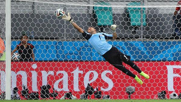 Keylor Navas at full stretch to make a save [via FIFA.com]