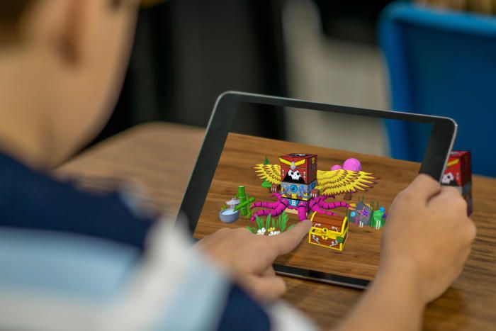 Meet SwapBots, an augmented-reality toy that pairs with the iPad.