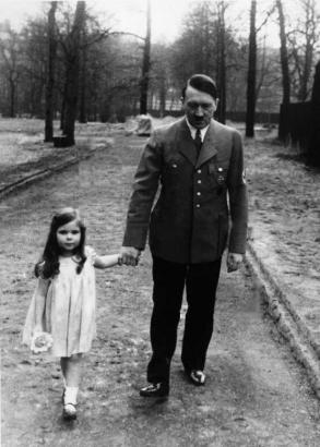 Adolf Hitler on a walk with Helga Goebbels, 1936