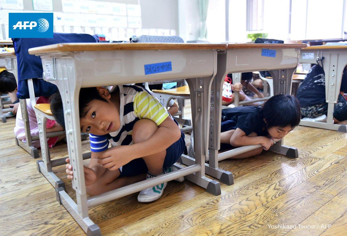 Tokyo Japan Children Sit Under School Desks During Tokyo