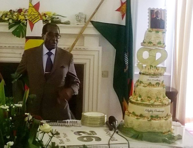 Robert Mugabe's staff have just presented him with a five-tier cake for his 92nd birthday
