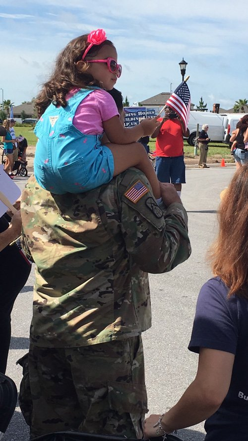 A U.S. Marine was given a 'forever home,' 150 teary onlookers came over to help celebrate.