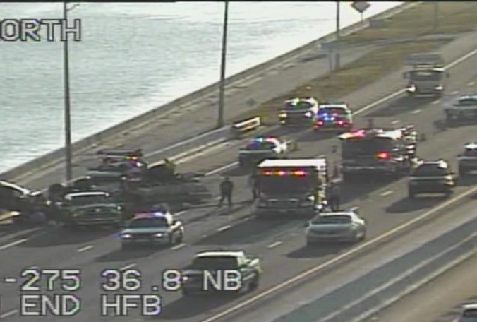 FHP: 1 car overturned, 1 on wall in Howard Frankland SB crash. Minor injuries, heavy delays.