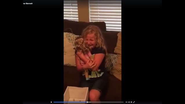 Girl surprised with doll with prosthetic