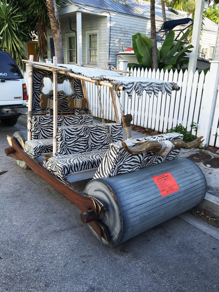 ONLY IN KEY WEST! A Flintstones car gets ticketed for being illegally parked.