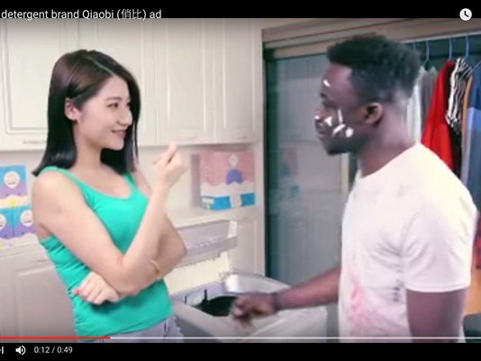 Chinese detergent maker sorry for harm done by racist ad.
