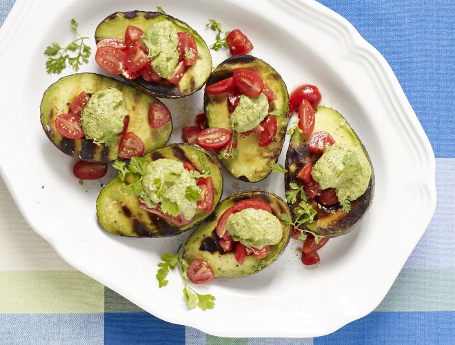 Grilled Avocados with Tomatoes & Cilantro-Almond Pesto -->