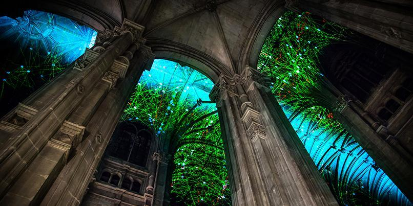 Artist Miguel Chevalier projects digital constellations onto 16th-century Parisian church.