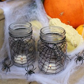 These Spider Web Mason Jars make a super easy last minute DIY Halloween decor project! ad