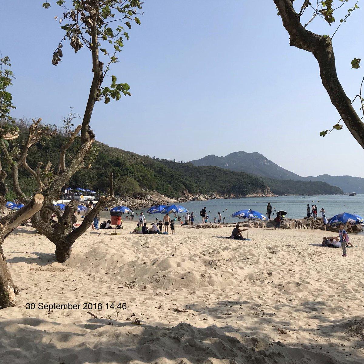 Sandy beach, warm day, & mountain view on Hung Shing Ye bay on Lamma island
