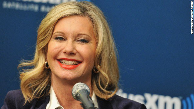 Olivia Newton-John is postponing her tour as she battles breast cancer for the second time