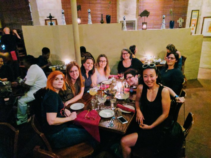 ladies from the WeRise tech conference around a table at dinner