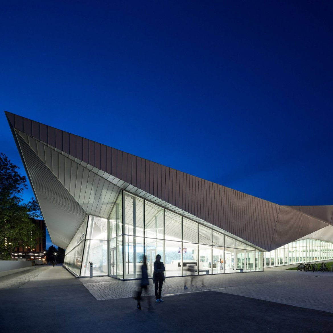 Angular white roof covers MJMA's glazed aquatic centre in Vancouver