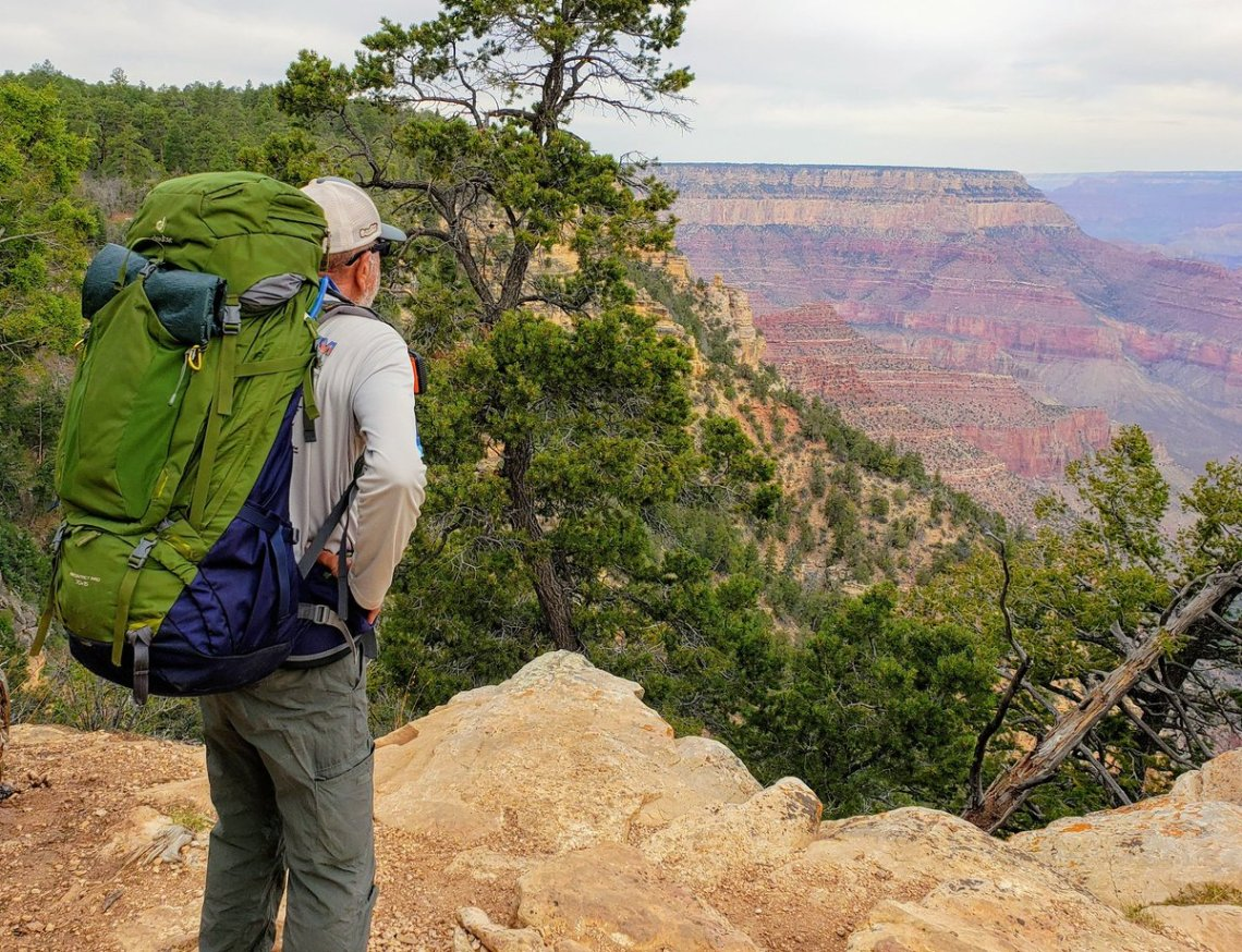 Karts Huseonica looks out over the Grand Canyon during his epic hike of the 800-mile Arizona National Scenic Trail