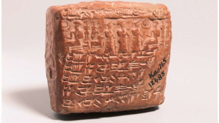 A cuneiform tablet on red clay, square-shaped. Credit: Turp, AB. et al. Gynecological Endocrinology, 2017 - via Realm of History