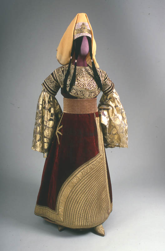 """This elaborate eight-piece costume is an example of the traditional festive dress of Moroccan Jewish women, worn by brides and at other celebrations. It is probably based on medieval Spanish Jewish costume, with its origins usually traced to the 15th century Spanish vertugada (hoop skirt, known as a """"farthingale"""" in England). - Flickr, via Center for Jewish History"""
