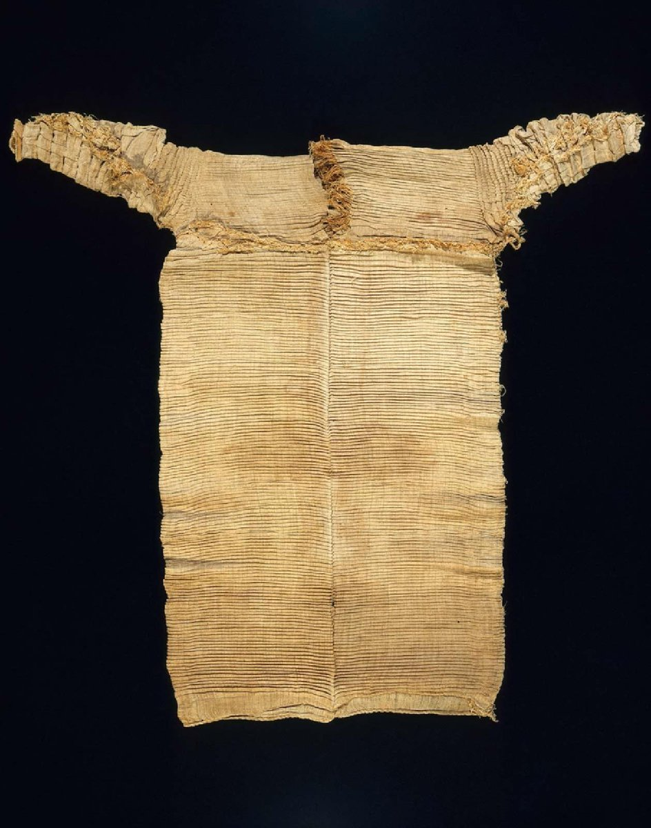 This dress consists of three pieces. The sleeves and half the bodice were made of a single piece of linen, which was sewn on top of the skirt, leaving a V-shaped opening for the neck. The pleating was most likely done by hand prior to assembly. After washing - with natron serving as soap - the pleating would have been redone for wearing.  Boston, MFA