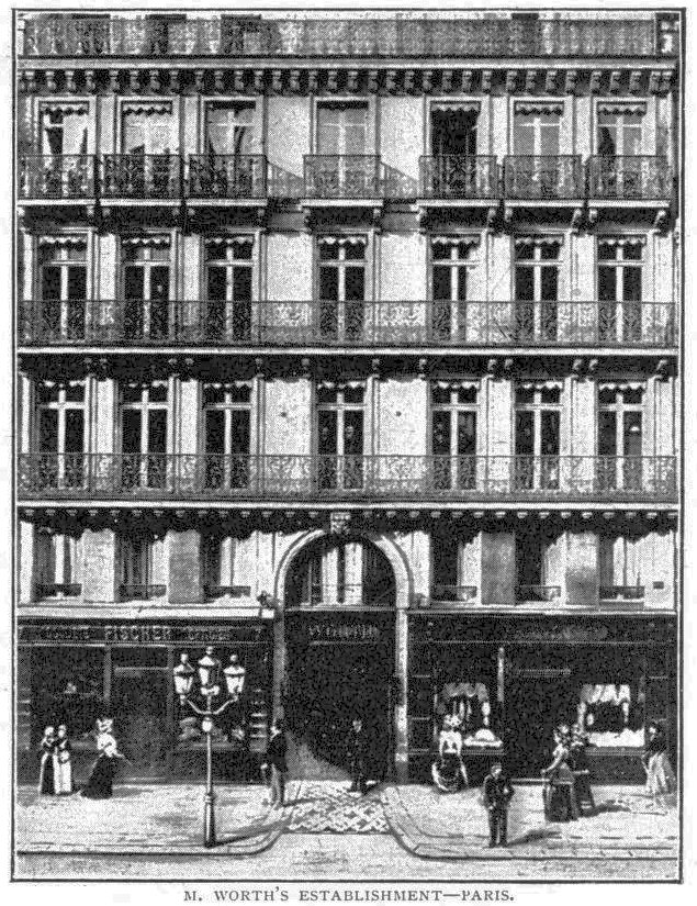 The Worth salon on rue de la Paix, public domain. A tall Paris building with lovely iron wrought balconies and high windows. Black and white photograph.