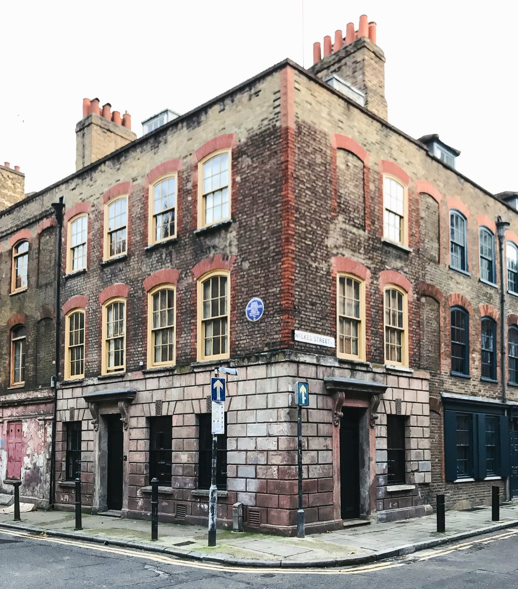 Anna Maria Garthwaite's home in Spitalfields, what is now 2 Princelet street. A three story brick home with large chimneys. It has eight windows on the top two stories, and a door and three windows on the first. It is a corner. Image via: https://www.skyeoneill.com/blog/2017/11/10/spitalfields-houses-anna-maria-garthwaite