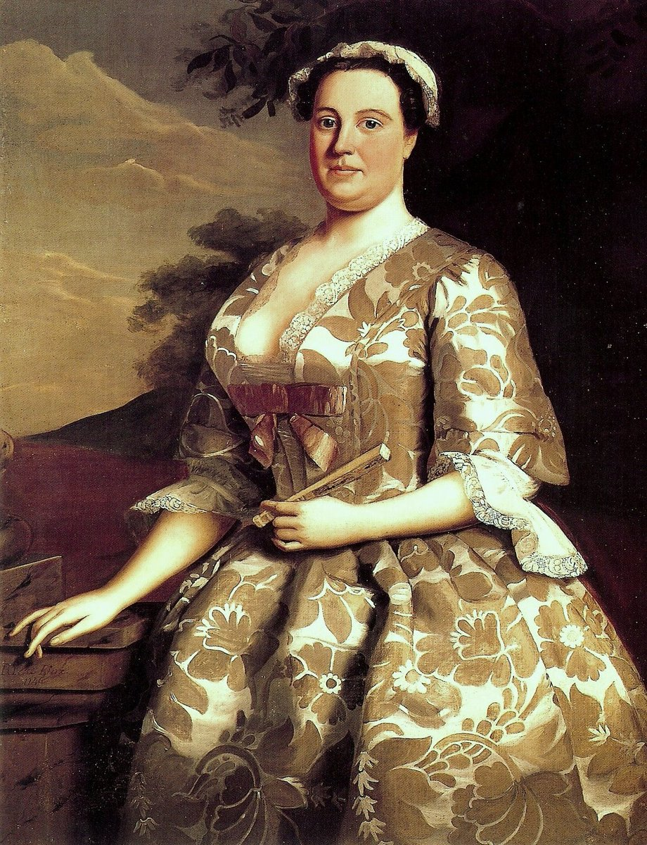 Mrs Charles Willing of Philadelphia was painted by Robert Feke in 1746 wearing a gown of English silk damask woven to a surviving 1743 design by Anna Maria Garthwaite. A woman standing at 3/4 length in a beige damask gown with a big bow and cap.