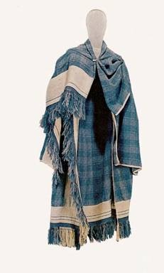 A recreation of clothing from Thorsburg, recreated -- blue plaid with white border.