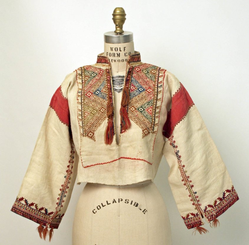 Blouse from the Met Museum, Croatia.  - Highly embroidered blouse from Croatia. Public Domain. Red patches on shoulders, dark red geometric designs on sleeve edges and chest.