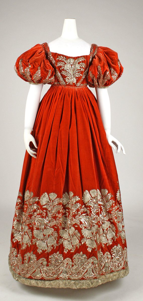 This dress gold embroidery with luxurious yards of velvet, drawing the eye up and down the folds and across the edges. From the Met Museum collection. Likely from Germany.