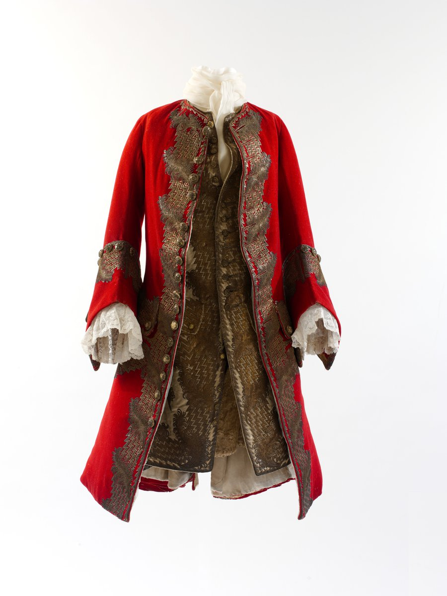 In the eighteenth century men's formal and court attire expressed, in forms only slightly less constrained than the womenswear of the period, a lavishness that was notable for the elegance of its finish and the finesse of its application of artisanal techniques. The elite of Western Europe and the Americas emulated styles originating in France since the time of Louis XIV. This coat, with its flaring peplum, or skirt, is a persistent silhouette favored at the end of the Sun King's reign that continued in modified form until the last years of Louis XV. - Met Museum, public domain