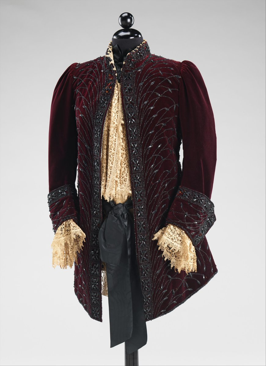This is an excellent example of late 19th-century dress imitating men's wear of the late 18th century. This Worth jacket eloquently imitates the silhouette and the ostentatious quality of court costume of the previous century. The extraordinary jet beadwork embroidery is stylized to represent the elaborate silk floss embroidery of the past to great effect. - The Met Museum, public domain.