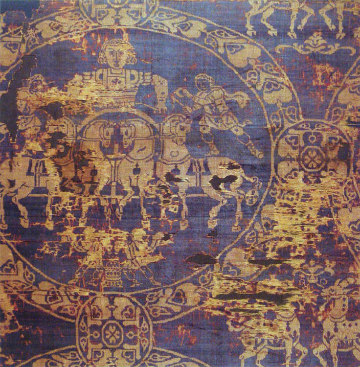 Burial shroud of Charlemagne with Tyrian Purple and gold, c.814 AD -- pictured a man on a chariot surrounded by horses. Figures in gold, background in purple. Somewhat tattered, but still lovely. Public Domain.