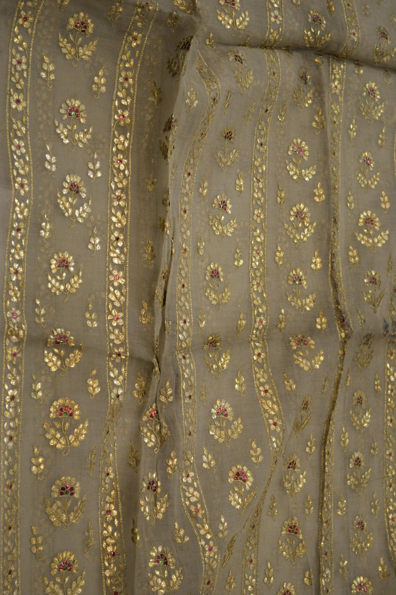 ©Victoria & Albert Museum, London - 1855. Chennai. Length of muslin, embroidered wth flattened gold wire and gold and green spangles. With vertical bands of floral design.